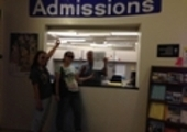 students at the admissions office window