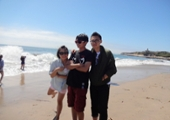 3 students by the water at natural bridges state beach