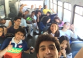 student take a photo of everyone on the bus