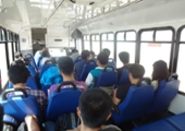 picture of students on the bus from the back